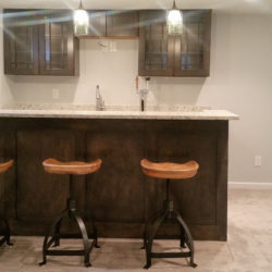 Wet bar in Littleton basement finishing project from Brothers Construction.