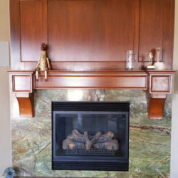 cherry mantle and paneled wall above basement fireplace
