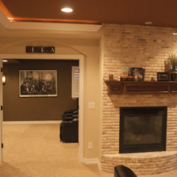 basement theater entry and fireplace overview