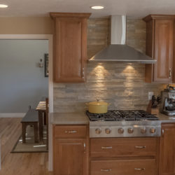 full height stack stone backsplash in Colorado remodel