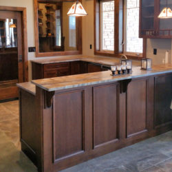Sandalus Satin granite bar counter in Back Country Colorado basement