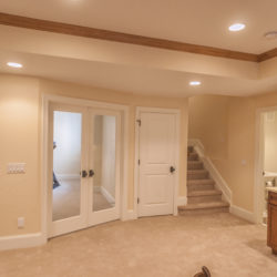 Finished basement with Shaw brand nylon carpet on floor and stairway.