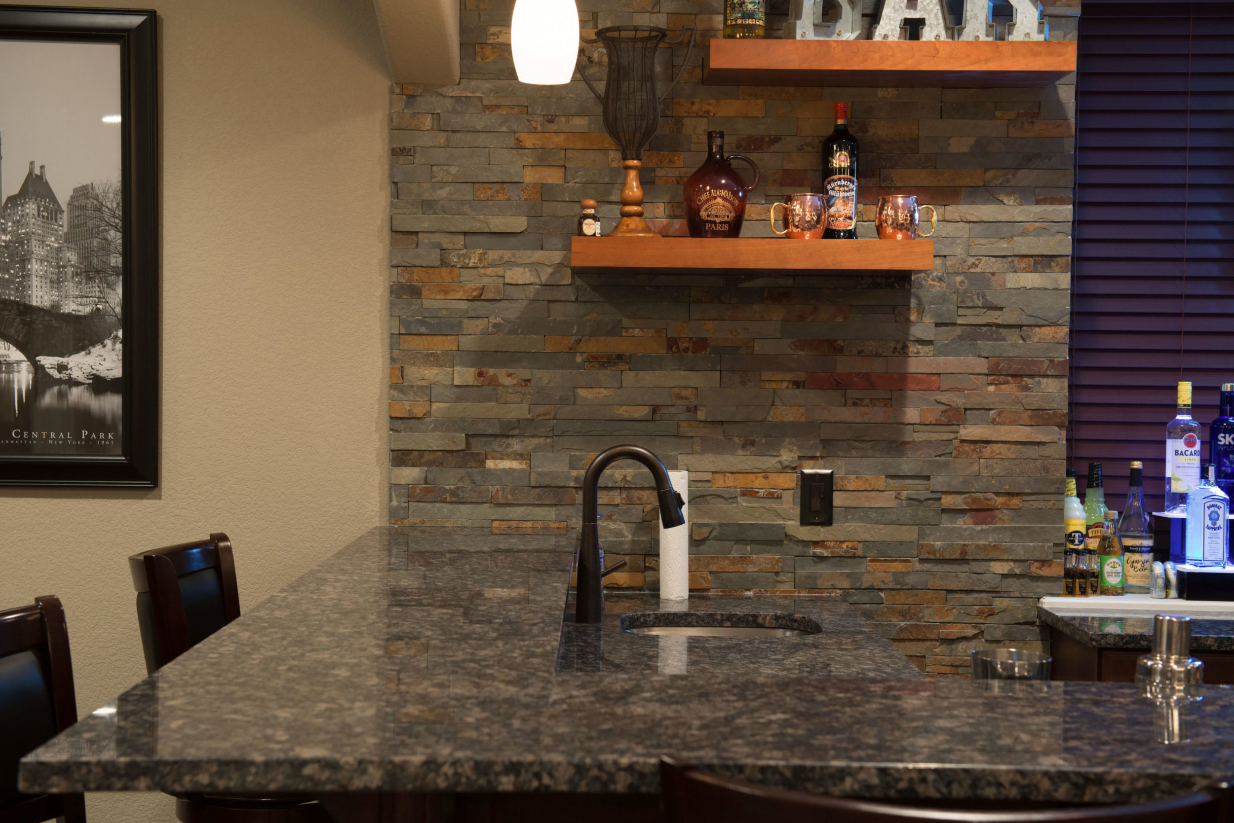 aurora colorado basement finish with stacked stone bar wall open