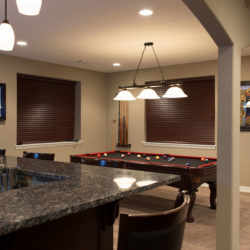 Parker, Colorado basement finish with walk behind wet bar, double arch ceiling detail and pool table