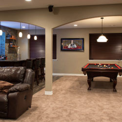Basement finish in Denver, Colorado with wet bar and pool table.