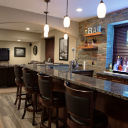 Basement design bar and rock wall idea